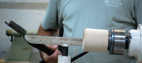 Photo: ... so that he can use it to put a tenon on the roughed out blank.