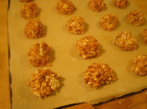 Using a tablespoon measure place chorizo mixture 1 inch apart on 1/2 of the...