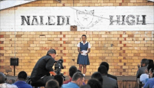 HAVING A SAY: Kelly Baloyi addresses the audience during the filming of an FNB advert campaign at Naledi High School in Soweto Photo: Matthews Baloyi