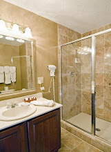 Photo: All of our luxury rooms have all marble bathrooms with a separate walk in shower and bath tub