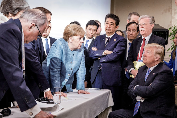 German Chancellor Angela Merkel, surrounded by other Group of Seven leaders, stares down US President Donald Trump at the G-7 summit in La Malbaie, Canada.The photograph by German government spokesman Steffen Seibert went viral. File photo: REUTERS