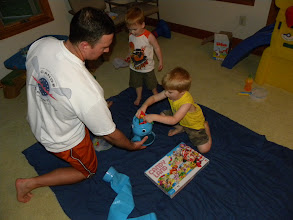 Photo: Daddy helped get the butterflies back inside the elephant for another turn.
