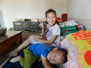 Photo: Namka's niece attends school in Mandarin, but also has to study Mongolian and English.  Her nephew is not in school yet, so he only speaks Mongolian.  They patiently taught me the numbers 1-10. When they weren't in stitches over my horrid pronunciation, that is!