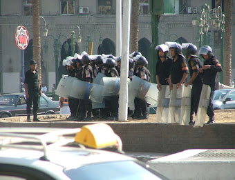 Police in Tahrir Square forming a barrier shortly after the Egyptian Revolution