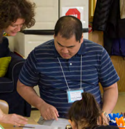 An instructor sharing information with a parent