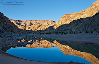 """Photo: """"Canyon Reflections"""" Fish River Canyon Ais-Ais/Richtersveld Transfrontier Park, Namibia  It's a glorious new day - here's hoping all my G+ friends have a peaceful and relatively calm week without too many stumbling blocks.  This photo was taken during a hike back in 2009 through the bottom/floor of the Fish River Canyon in Namibia. It's the world's second-largest canyon (guess which one is the largest??) and the hike is a 5 or 6 day endeavour over some tough terrain which includes thick riverine sand, large boulders, small mountains and endless smaller rocks that you need to step on. You cross the river on many occasions, often having to take off your shoes and even float your backpack across, depending on the water level and the amount of rain during the wet season. The route is closed between October and May because of the sheer temperatures in this desert environment (it can reach over 50 degrees Celcius on the floor of the Canyon).  I created this images at the start of our 3rd day after we packed up our makeshift camp and started to strike out for the day. This one is for my friends +Anette Mossbacher(who was there recently),+Grobler du Preez, +Berndt Weissenbacherand +Dick Whitlock.  This photo is Copyrighted © Morkel Erasmus Photography.  You may share this image as presented here under the Cr+eative Commons Attribution-NonCommercial-NoDerivs 3.0 licence (CC BY-NC-ND 3.0) http://creativecommons.org/licenses/by-nc-nd/3.0/  Submission for: 1. #mountainmonday (+Mountain Monday) by +Michael Russell 2. #mirrormonday (+Mirror Monday) by +Gemma Costa+Elizabeth Edwards 3. #naturemonday (+NatureMonday) by +Rolf Hicker+Kate Church 4. #landscapephotography (+Landscape Photography) by +Margaret Tompkins+paul t beard+David Heath Williamsetc 5. #moodymonday (+Moody Monday) by +Carole Buckwalter+Philip Daly 6. #plusphotoextract & #potd   #canyon  #Namibia  #FishRiverCanyon #PassionforAfrica #mountains  #cliffs  #reflection  #river  #hike +Discover Africa+Africa Geogr"""