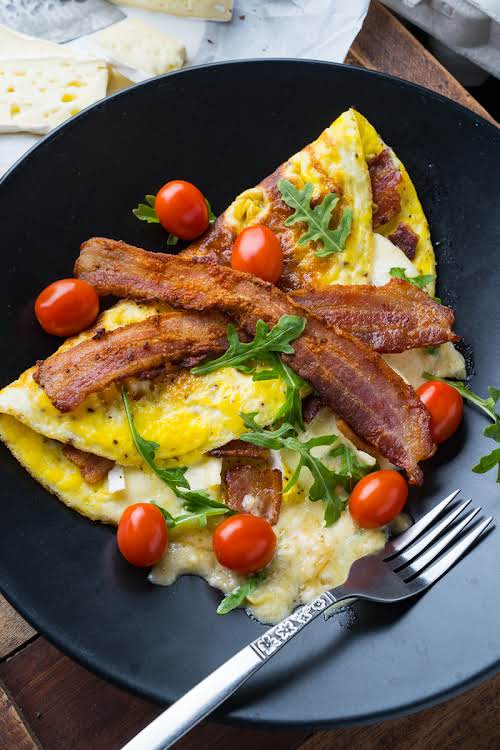 """Bacon and Brie Omelette""""A soft and fluffy omelette stuffed with bacon and..."""