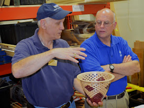 Photo: Barry Zalcman explains to another member how the segmented bowl is put together while they wait for the next segment to begin.