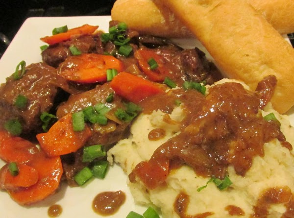 Serve with Mashed Potatoes, adding gravy over potatoes if desired, and garnish with chopped...