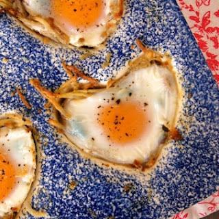 Potato Crusted Eggs Florentine with Prosciutto