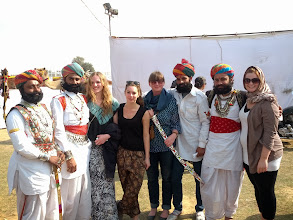 Photo: We happened to be in Bikaner for the camel festival.  Here's Sarah with this year's Mr Bikaner, among others.  The festival, I gather, is largely a tourist event, and a chance for the locals to laugh at foreigners.  We participated in the foreigners-only turban tying contest (hopefully photos to come) and foreigners-vs-indians tug of war, which we lost handily.  We were then interviewed by about a dozen local press. Celebrities again.