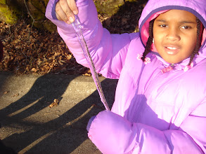 Photo: Kaleya shows off an icicle she plucked off a rock