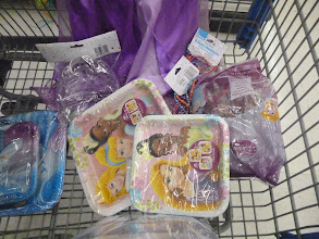 Photo: Party stuff. Favor bags, necklaces, plates. Just realized that we don't have princess napkins. Have to add that to the list for when we go back to Walmart for the Retailtainment event.