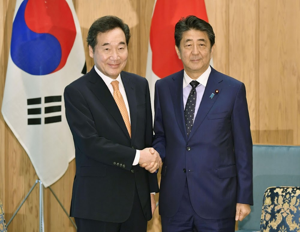 Japan and South Korea pledge to repair ties