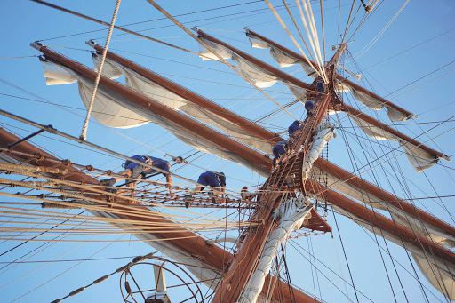 sea-cloud-mast.jpg - Deck hands ready the ship's sail on National Geographic's Sea Cloud.