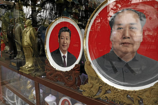 Souvenir plates with images of the late chairman Mao Zedong and Chinese President Xi Jinping are displayed at a shop during the 19th Communist Party Congress in Beijing, in October 2017. Picture: REUTERS
