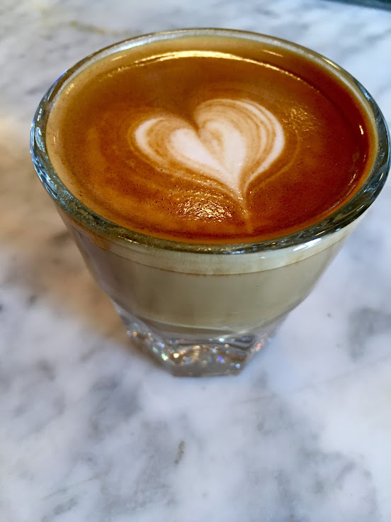 An off-the-menu option: the Cortado.  Half espresso, half steamed milk.