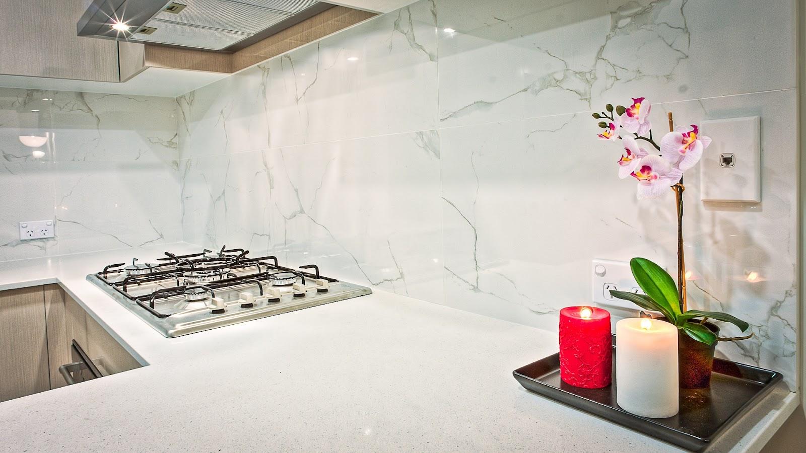 white modern kitchen backsplash next to stove