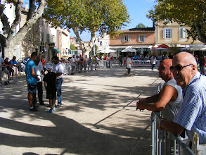 Photo: Petanque is said to be played every day of the year on this square, and today is the finals of a tournament.