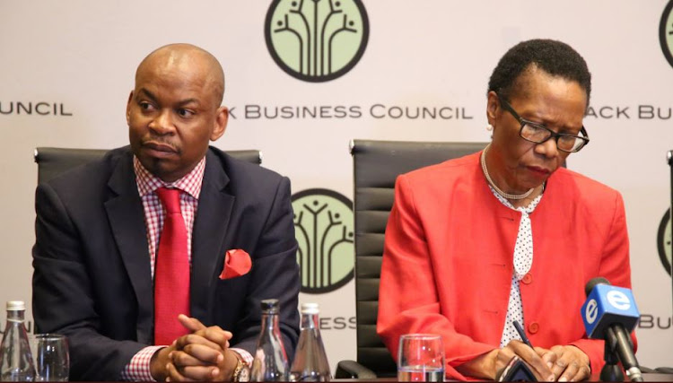 Black Business Council‏'s Secretary General, George Sebulela, sits next to the organisation's president, Dr Danisa Baloyi.