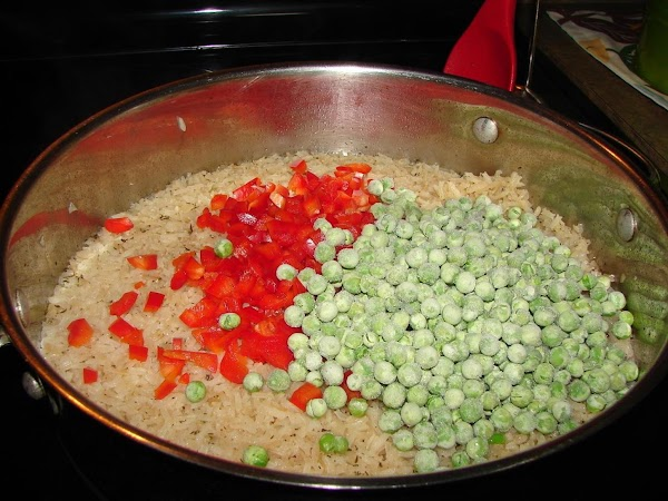 Add peas and sweet pepper. Stir until heated through.