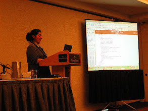 Photo: Susan Malaika, IBM, a great presenter. She distributes english toffees in the middle of her talk. Nice presentation trick!