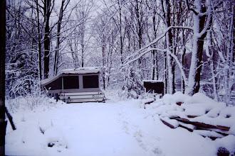 Photo: Camper in winter snow land.