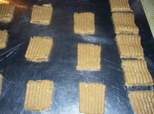 Fill cookie press. Use the star plate. Form long strips of dough on unoiled...