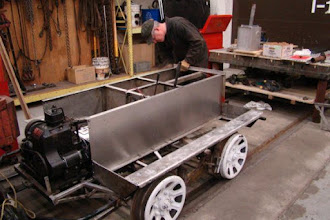 Photo: Side view of chassis with new aluminum tunnel wall set in place.