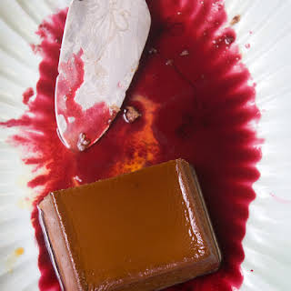 Creamy Chocolate-Cheese Flan with Hibiscus Sauce.