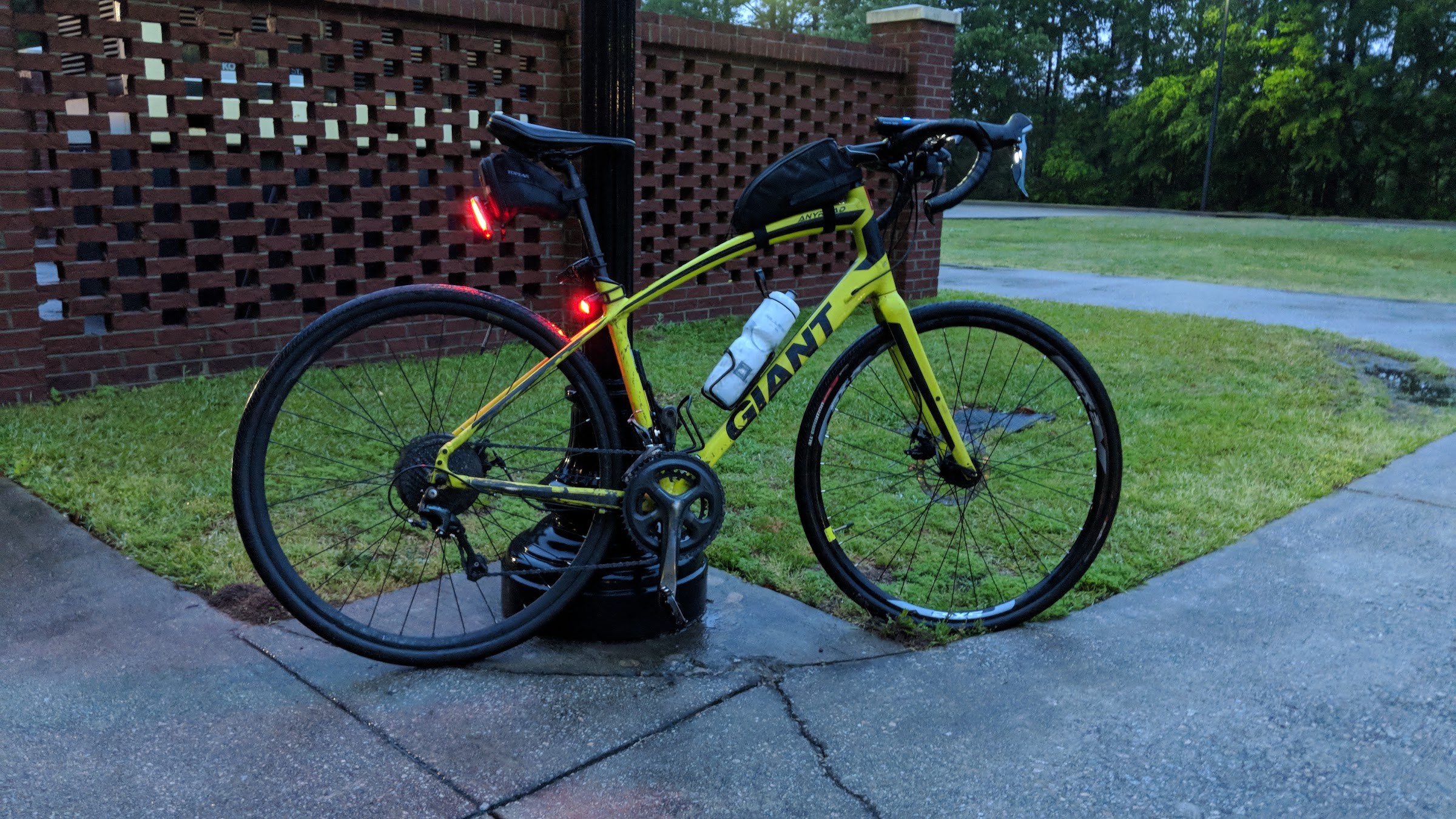 Bike leaning against light post at work