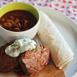Slow-Cooker Mexican Beef With Lime Crema and Pinto Beans.