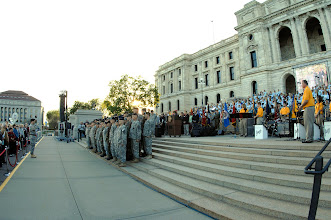Photo: A color guard and formation took position on stage following performances by the Minnesota All-State Choir and Band during a ceremony held in front of Capitol Building for Minnesota State's Sesquacentennial.