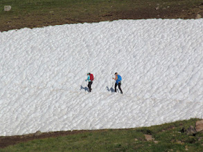 Photo: Hikers crossing a snow field