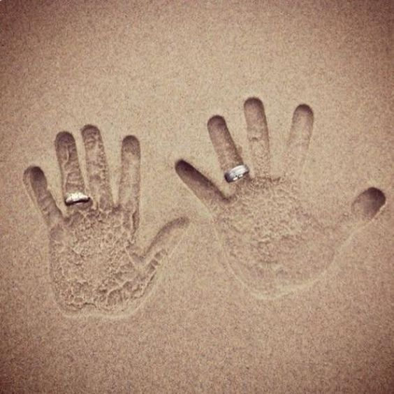 wedding bands in sand