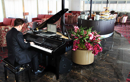 amaserena-piano-lounge.jpg - Relax to soothing piano music during your sailing on Europe's waterways on AmaSerena.