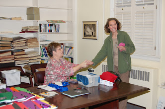 Photo: Pam welcomes Anita to registration on Saturday Morning.