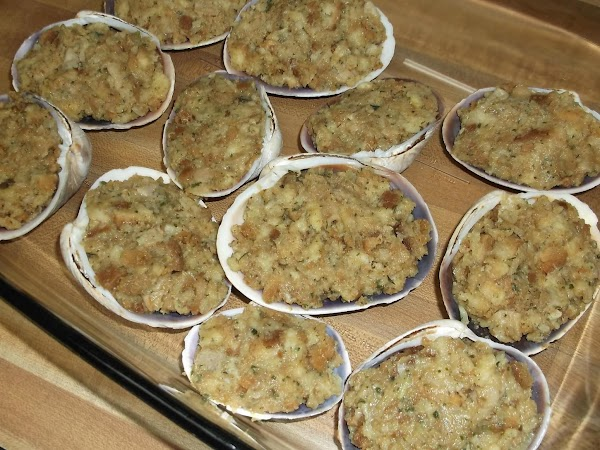 """Spoon mixture into empty, clean clam shells. Place filled shells in a 9""""X13"""" baking..."""
