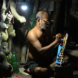 Concentration by Subhajit Biswas - People Portraits of Men ( kolkata, artist, painting, concentration, kumartuli, india, durga puja )