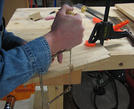 Photo: Removing most of the waste between the tails with a coping saw