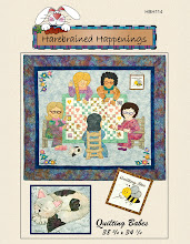 "Photo: Also coming this spring is HBH 114 - ""Quilting Bees"" This wallhanging is 38 3/4 x 34 1/4. It is a applique wall hanging featuring five ""babes"" around a pieced quilt with a kitten sleepig lazily at their feet and a Quilting Bee framed on the wall. Change up the hair colours and make it for your quilting and sewing friends."