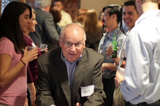Photo: SBA 504 Loan Expert, Geof Longstaff, had to squeeze his way through the crowd. www.504Experts.com