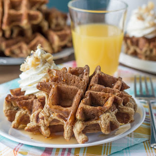 Whole Wheat Carrot Cake Waffles with Cream Cheese Whipped Cream.