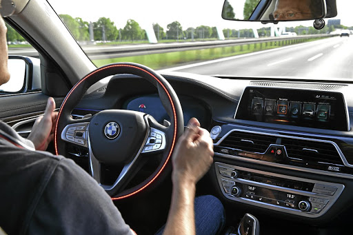 The company says the steering wheel will remain for those who want to drive.   Picture: BMW