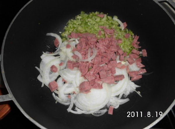 Bake potatoes and allow to cool.  Dice bacon, slice onions, mince garlic, and...