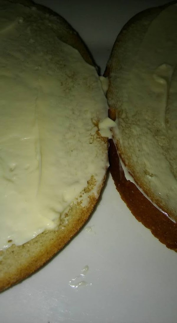 Place two slices of desired bread on a plate. Spread each slice with mayonnaise...