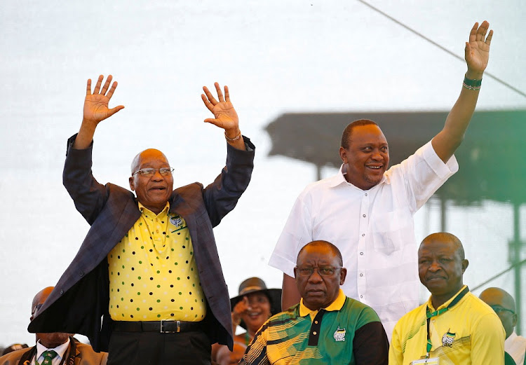 President Jacob Zuma (left) greets supporters with Kenyan President Uhuru Kenyatta at the ANC's 106th anniversary celebrations as ANC president Cyril Ramaphosa and his deputy, David Mabuza, look on in East London at the weekend. Picture: REUTERS