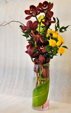 Photo: Cymbidium, Roses in Cylinder Vase $50.00 each