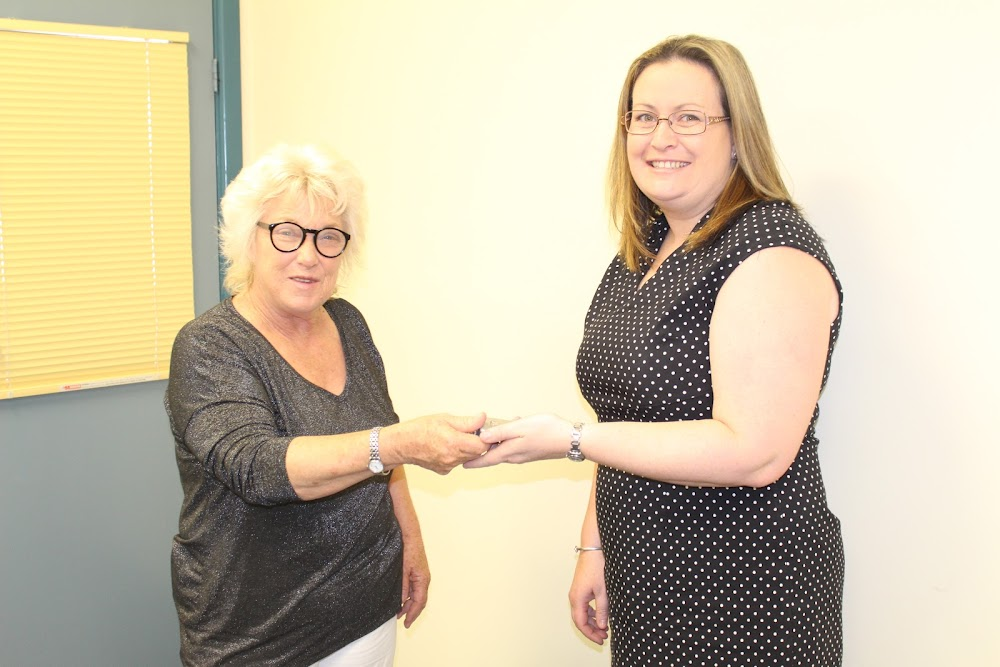 The mayor Cathy Redding hands the keys of the door to Country Universities Centre manager Cathy Walters on Monday.
