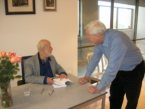 Photo: Erich signing John Rice's copy